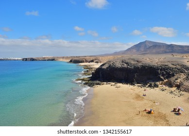 Papagayo, Lanzarote - June24, 2008: People relax on  the famous Papagayo Beach on the Lanzarote Island in the Canary Islands, Spain