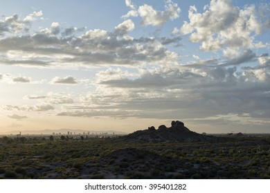 Papago Park hill and Phoenix downtown skyscrappers during sunset
