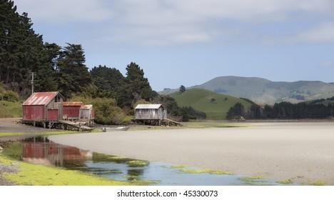 Papanui Inlet boat houses, Otago Peninsula, New Zealand