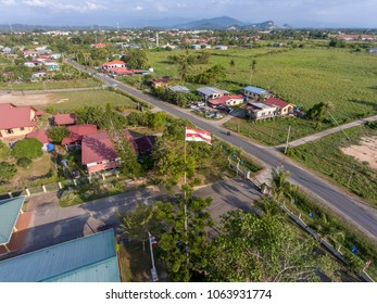PAPAR, SABAH, MY - APR 08, 2018: UMNO (United Malay National Organisation) political campaign flag hoisted up high above tree lines for the Malaysian 14th general election in May 2018.