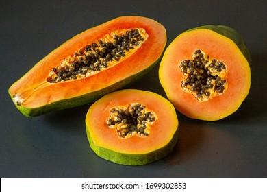 papaya fruit isolated on the black background