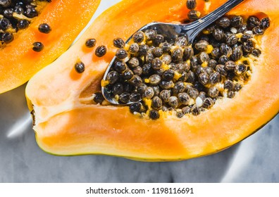 Papaya fruit on white marble background.