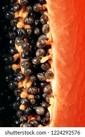 Papaya fruit (Paw Paw) half Macro image viewed from above with seeds