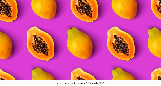 Papaya fruit seamless pattern on purple background, flat lay, top view