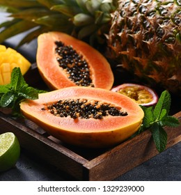 Papaya fruit, sweet ripe fresh papaya, mango, pine apple, raw vegan food, tropical fruits, square image