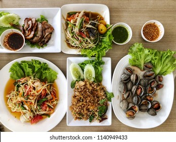 Papaya salad, grilled pork, parboiled cockles and spicy minced pork, which is the food of the Northeast of Thailand.