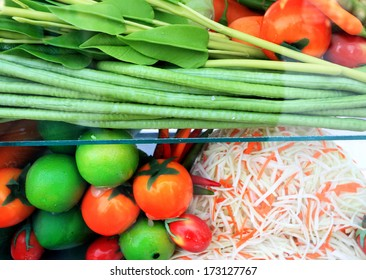 Papaya salad ingredients in a glass