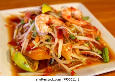 Papaya salad with shrimps, Traditional spicy Thai food. Selective focus