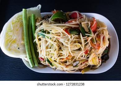 Papaya salad. Spicy green papaya salad or Som Tum Northeast food of Thailand.
