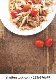 Papaya salad Thai food on wood background