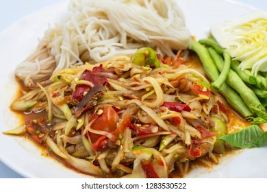 papaya salad Thai style : in Picture is Som Tam Thai northeast. Have fresh vegetable and Noodles, Very tasty, original Thai northeast style food.