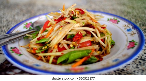 Papaya salad. Traditional spicy Thai food.