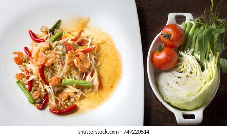papaya salad and vegetable on wooden plate, Thai food