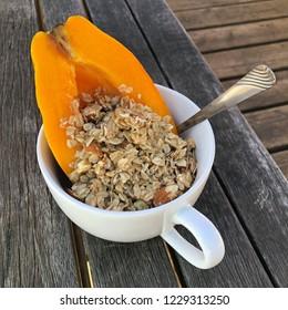Papaya and scoop of granola