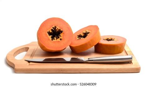 Papaya slice with knife isolated on white background