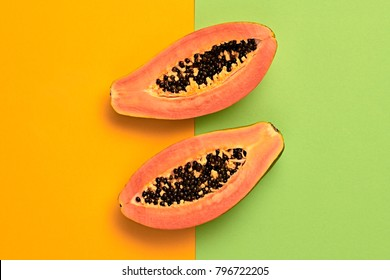 Papaya Tropical Fruit. Bright Sweet Color. Flat lay. Trendy fashion Style. Minimal. Hot Summer Vibes. Orange, Surreal. Detail, Pop Art