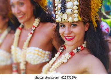 PAPEETE, FRENCH POLYNESIA - APRIL 25, 2017 : Polynesian women perform traditional dance in Tahiti Papeete, Polynesian dances are major tourist attraction of luxury resorts of French Polynesia