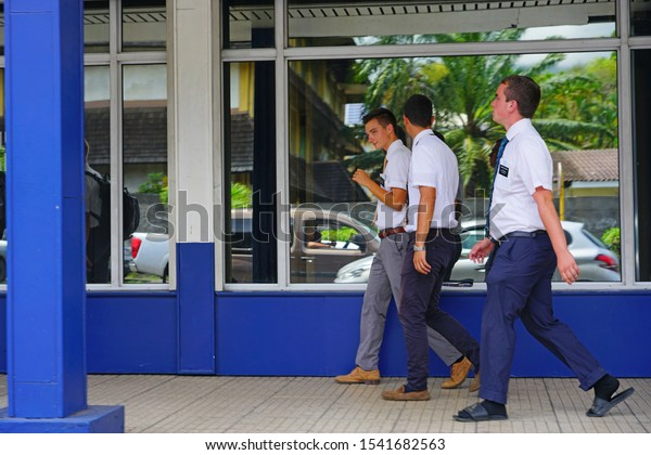PAPEETE, TAHITI -10 DEC 2018- View of young Mormon missionary men walking on the street in Papeete, Tahiti, the capital of French Polynesia.