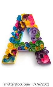 Paper ABC letter made in quilling crafting technic