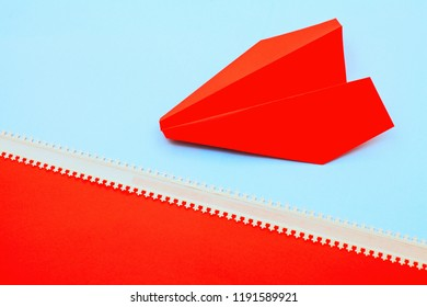 paper airplane on red and blue background