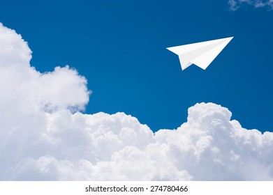 Paper airplanes fly over blue sky in freedom concept