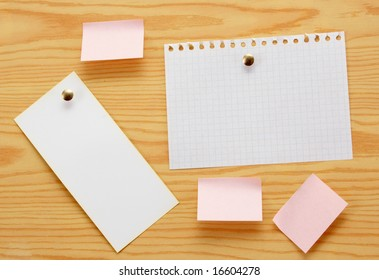 Paper for announcements of the different size on a background of wood.