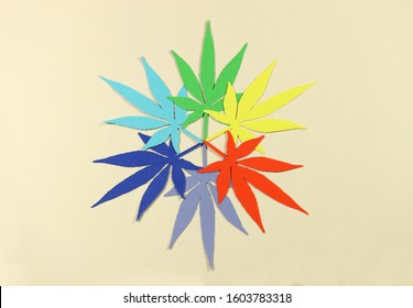 Paper applique paper hemp leaves on colored backgrounds. The concept of legalization.