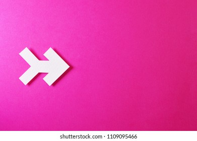 Paper arrow shapes on color background, ideal for your creative projects or direction topics.