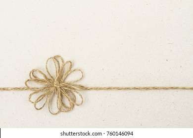 Paper Background and Vintage Ribbon Bow, Recycled Carton with Twine Rope Wrapping Gift