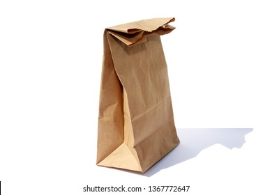 paper bag. brown paper bag.  isolated on white. room for text.  lunch bag on white.
