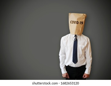 Paper bag with coronavirus tittle, on the head