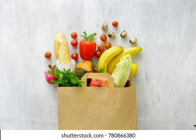 Paper bag of different fresh health food, top view