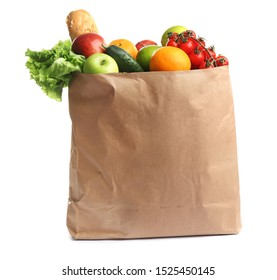 Paper bag with different groceries on white background