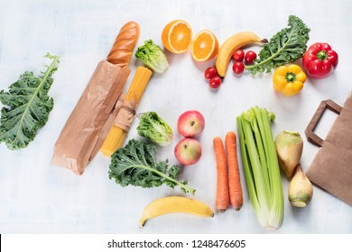 Paper bag and different healthy food. Top view. Flat lay