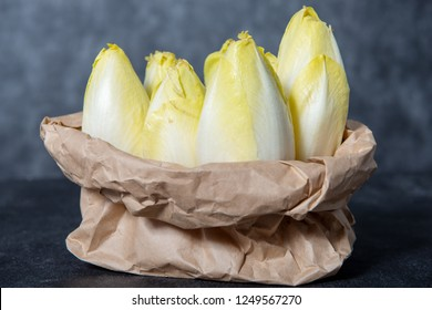 a paper bag with endives from France or Belgium