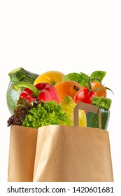 A paper bag filled with vegetables and fruits. Purchase of products.Isolated objects on white background.