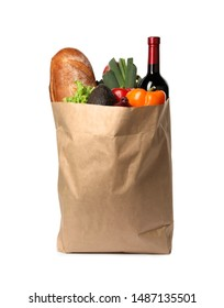Paper bag with fresh vegetables, bread and bottle of wine on white background
