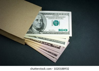 Paper bag with money on a blue background. corruption, bribe concept. selective focus. close-up
