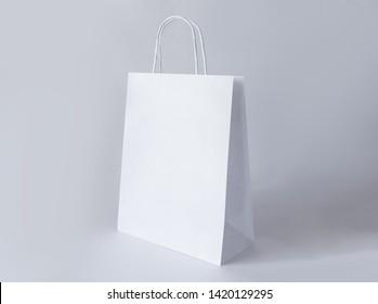 Paper bag on light background. Mockup for design.