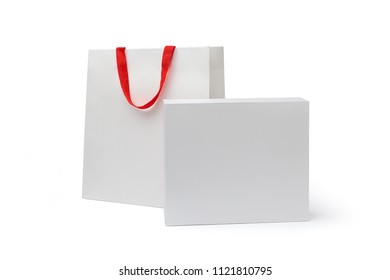 Paper bag with red handle and box. Isolated on white background