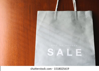 paper bag with Sale tag , midnight sale season end of the year