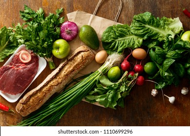 Paper bag set healthy food on dark background. Top view. Flat lay. Concept buying healthy food