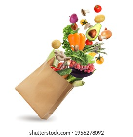 Paper bag with vegetables and fruits on white background. Vegetarian food  - Shutterstock ID 1956278092
