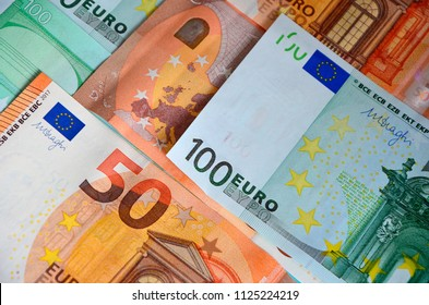 Paper banknotes of Euro 50 and 100. Cash close-up, color background of money view from above.