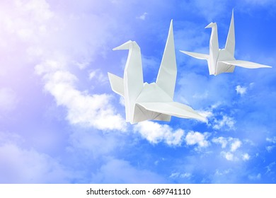 Paper birds together in the sky