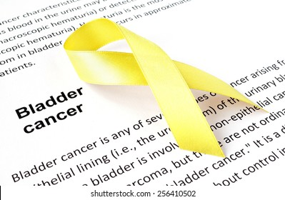 Paper with bladder cancer and yellow ribbon