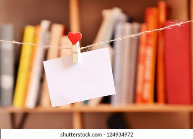 Paper blank hanging on clothespin with heart