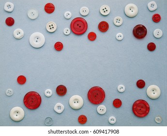 Paper blue background with a pattern of buttons. Frame for text made from multi-colored buttons.