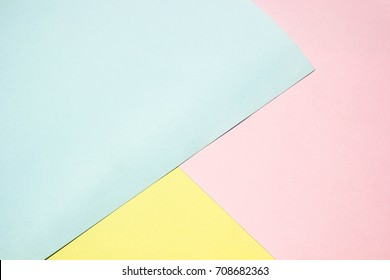 Paper blue soft pink and yellow colorful texture background,creative plain concept slight,can use pastel drawing or text. and weight light ,elements geometric