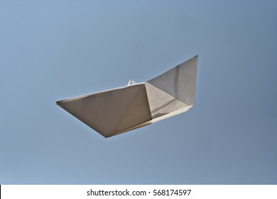 paper boat against blue sky